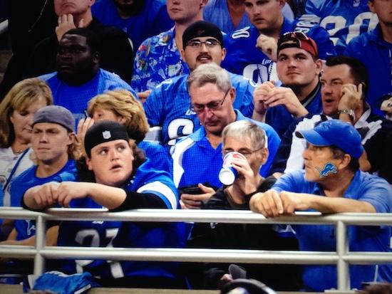 Dad Checking Fantasy Football Team